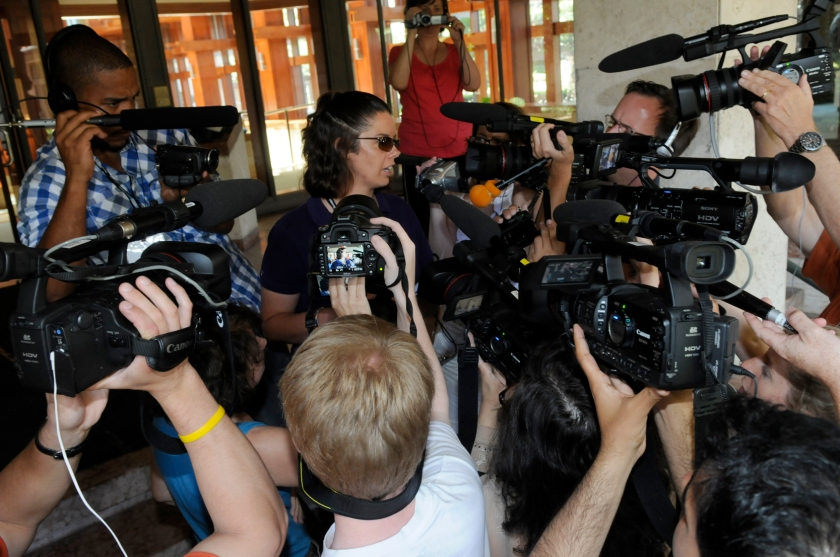 Poynter Backpack participants shoot a news conference in a Breaking News exercise.